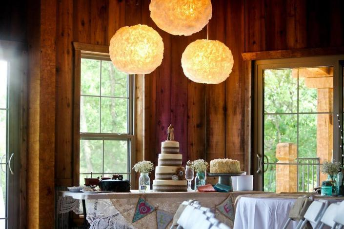 Burlap and Lace barn wedding theme cake table with white hydrangea and babies breath and blue mason jars with coffee filter paper lantern lights]